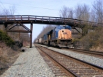 CSX E711 ducks under the timber bridge at MP 58.5
