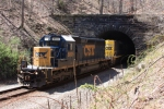 CSX 8805 and the Q411 emerges from the east portal of the Davis Tunnel