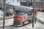UP 5702 passes by BNSF 784