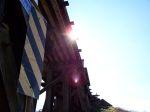 Sun peeping over MSCI's trestle crossing Hwy 178,