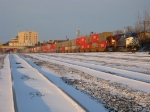 CEFX 1027 leads a eastbound intermodel out of town at sunrise