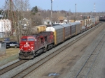 CP 8556 leads a westbound intermodel out of town