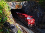 CP 9831 blasts out of the Buda Tunnel just as the sun comes out the wreck the shot