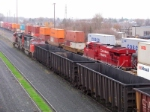 CN coal empties making its way through CP's westfort yard as the tail end remote of an intermodel passes