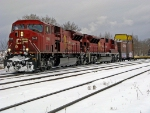 Two soon to be stored cp sd 90mac's pull CP 434 out of Thunder Bay. Note Icicle breaker behind the units