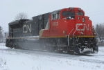 CN 8803 back through town in this April Snow Storm