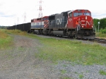 Cn coal train arrving Thunder Bay. Conductor getting off to throw the switch to join onto the CP to head to TBTL
