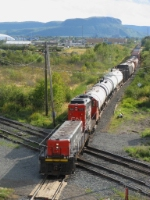CN 7278 and its slug pull a transfer move across town and over the CP main