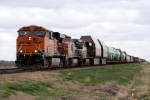 BNSF 7750 leads 3 737s and a manifest of cars west undercloud cover.