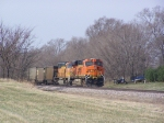 BNSF 5987 & BNSF 9928 Push Empties Past a Stored Boat and an Old Trailer