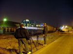Railfans taking night photos.