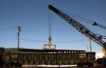 BN 559340 aiding Rail Crane in Action