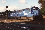 A pair of SD45-2s push on the rear of a train  at CP MO in the morning sun