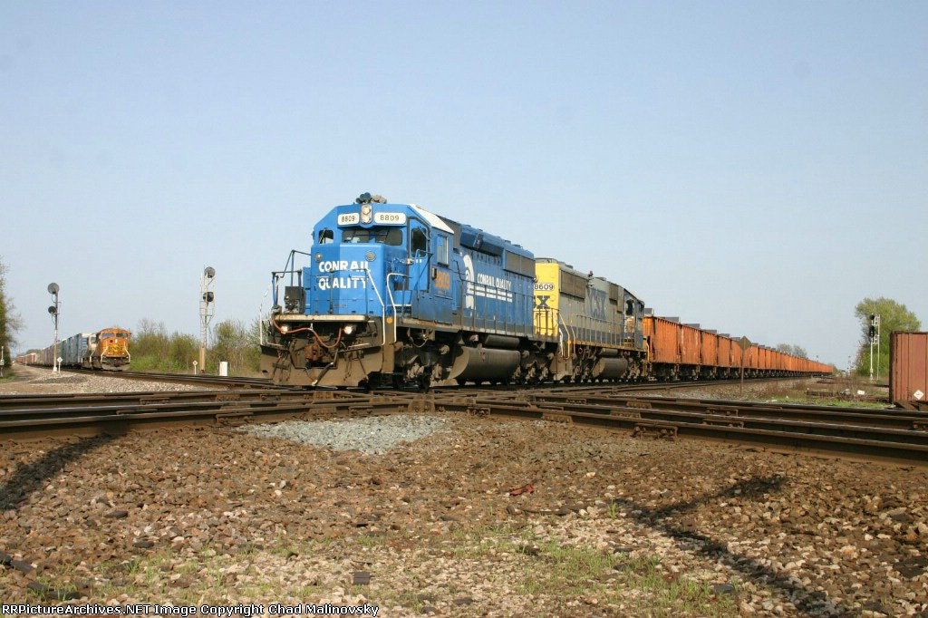CSX 8809 goes to tie down in the yard while CN WB waits