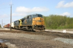 After flagging the diamonds, CSX 7318 continues east