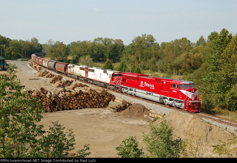 INRD train Z490 passes sawmill