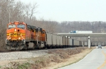 BNSF 5674 heading south with a TXUX coal train as a 18 wheeler passes over head on hiway 171