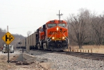 BNSF 6025 heading north with a empty TXUX coal train as MOFW looks on after fixing a broken rail