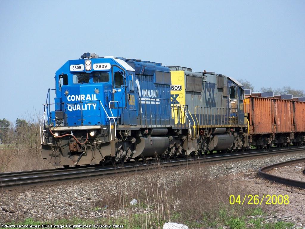 CSX 8809 leads west bound ballast train