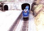 CR 6387 leads a freight out of the tunnel