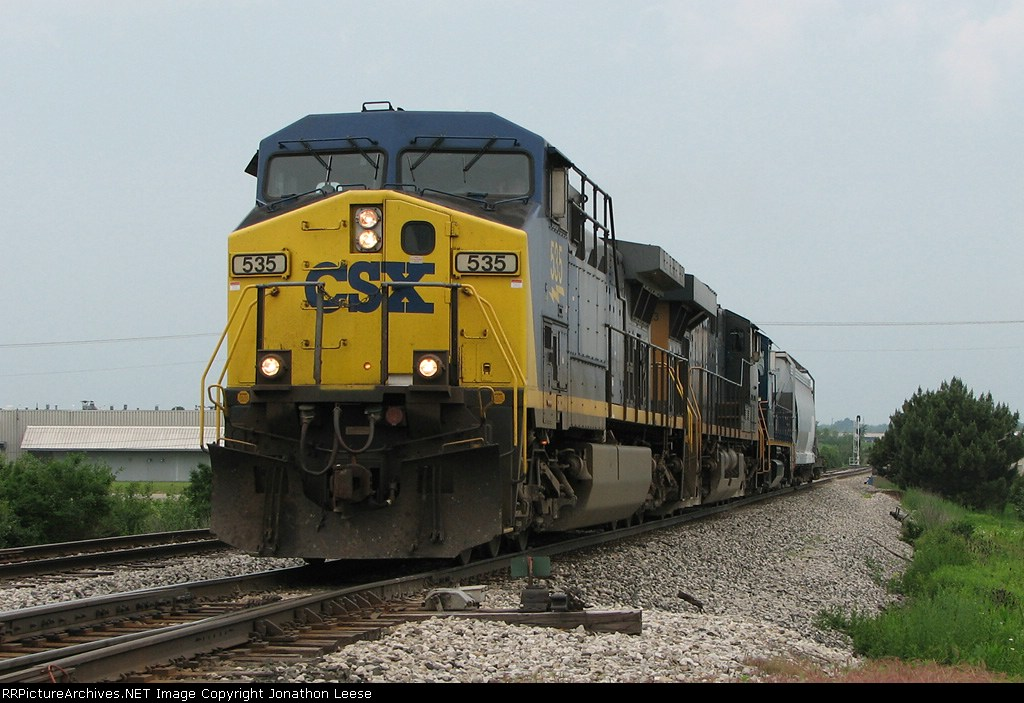 CSX 535 leading Q326 east with 3 units, 1 car and an RC sled