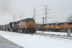 UP 7163, rolling meet. Note guys messing around with the powerlines in the background