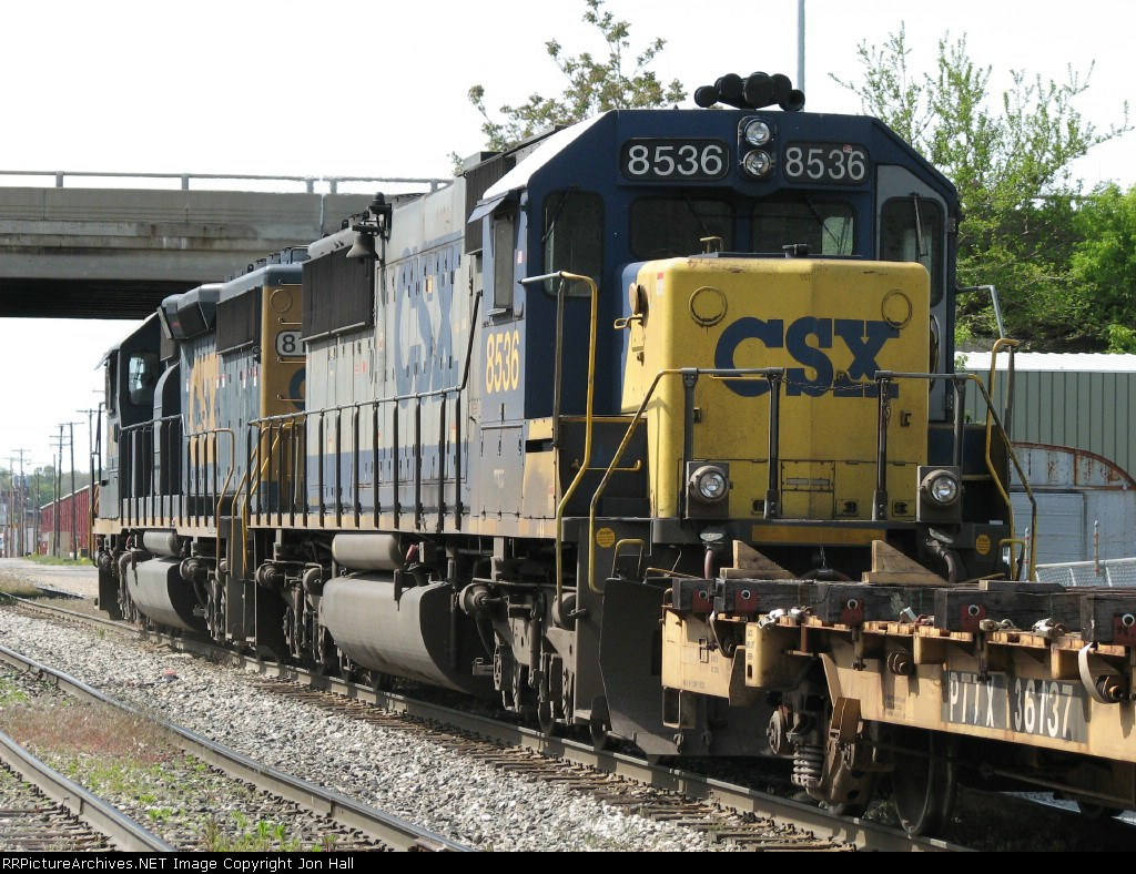 CSX 8536 trails eastward with its black numberboards