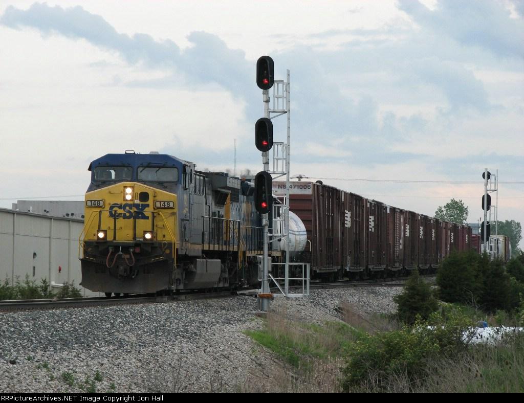 CSX 148 leads Q327-30 past the west end signals