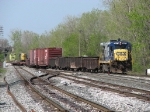D008 pulls through Lamar with a train of track equipment