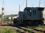 MQT's Z151 heads south across Fuller Diamond as the GRE crews works in the yard