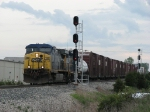 CSX 148 leads Q327-30 past the west end signals