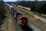 Here's a closup of BNSF C44-9Ws 5408, 5329, and 670 with their train at the Eisenhower Terrace Bridge.