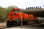 BNSF 5990 leads a westbound KPL train past the Lawrence Depot