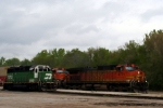 BNSF C44-9W 4771 leads an eastbound intermodal past yard goat 2702.