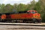 "BNSF C44-9W 4341 leads a eastbound ""worm"" grain train."