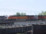 BNSF 7710 #3 power in a WB piggy-back at 10:11am