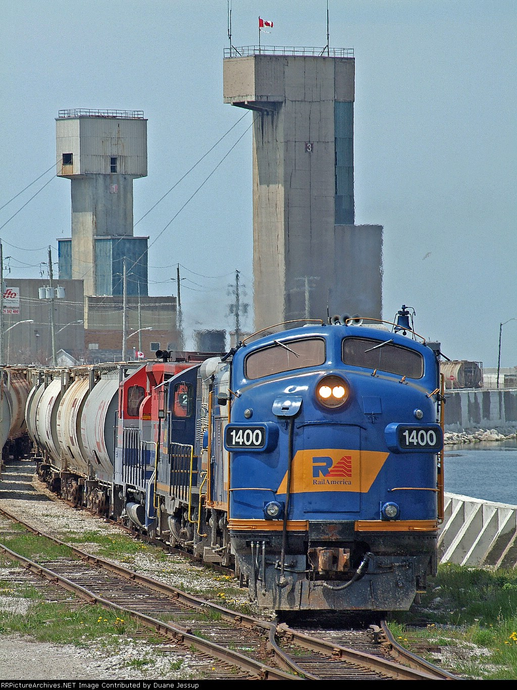 Railink 1400 with a trio of others spot hoppers at the salt mine in Goderich, Ontario