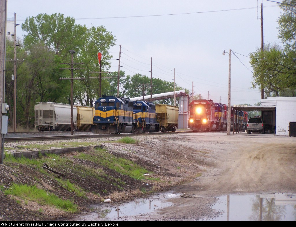 ICE 4203 and DME 3830 Sit in the Yard as a IC&E Train with 6 Locomotives Passes