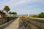 Kelso depot, California. One may notice the decreasing downhill slope when looking at the rear of the stack train in the background.