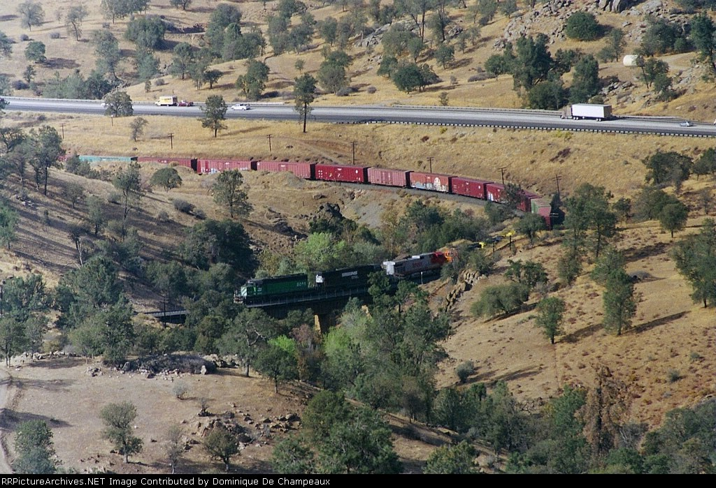 BNSF train on the 5th crossing of Tehachapi Creek. Former BN SD40-2 at the point.