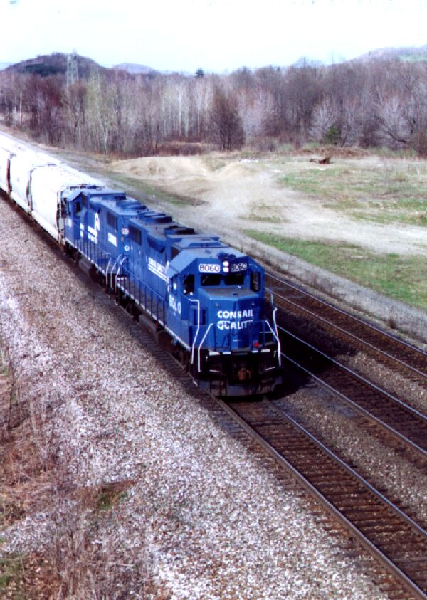 CR 8060 leads a freight