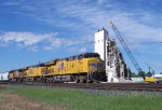 UP 7788 passes old elevator