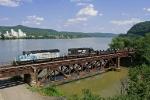The Maersk Unit leads coil train over Yellow Creek with the Ohio River in the background