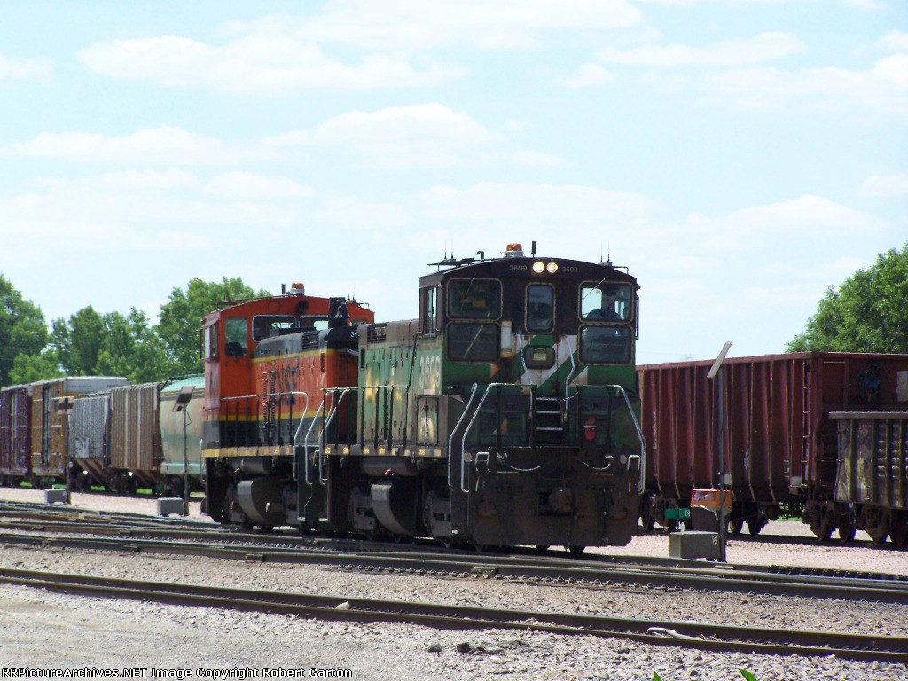 Switchers Move Down a Yard Track