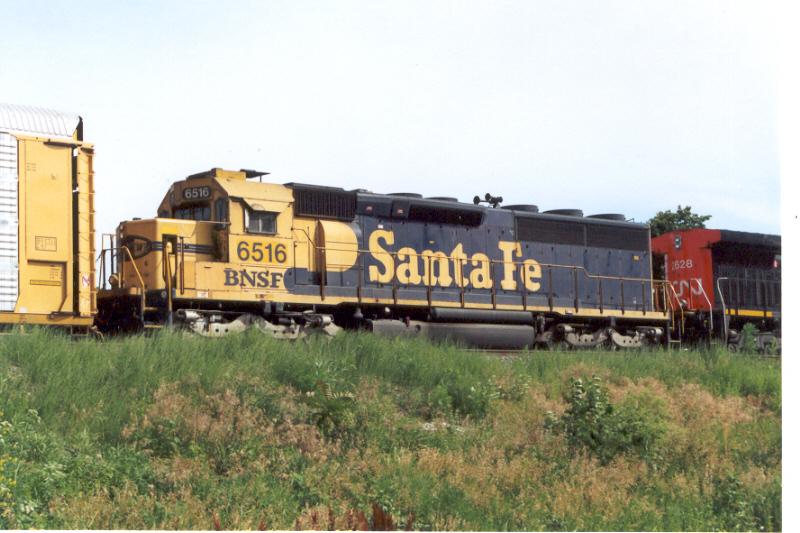BNSF 6516 on former BN trackage led by a CN dash-9
