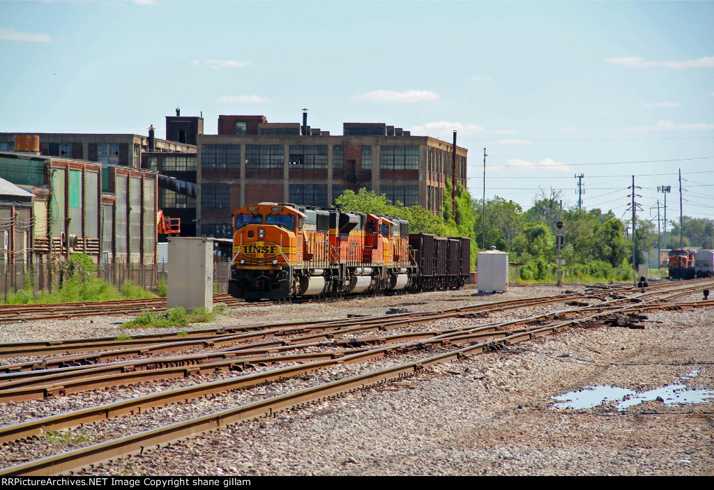 BNSF 8897 and its sister's are tied down on a ore train.
