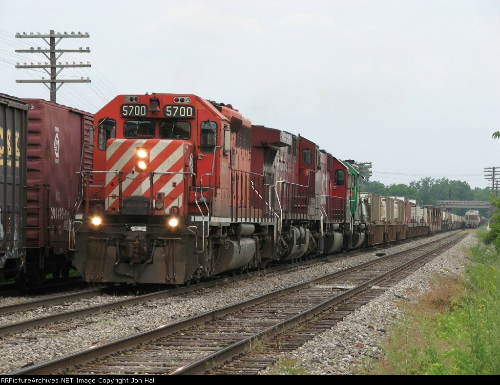 X741-24 pulls out of the yard while its conductor does a roll by inspection
