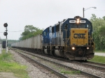 D006 heads west with ballast cars in tow for dumping along the Grand Rapids Sub