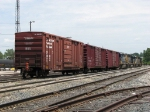 3 boxcars trail 4 SD40-2's as Q326 heads east