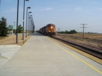 BNSF 5142 charges hard by Modesto with an eastbound manifest